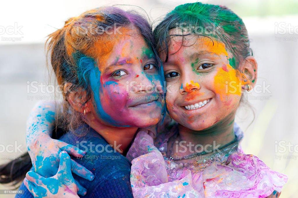 Two girls celebrating holi stock photo