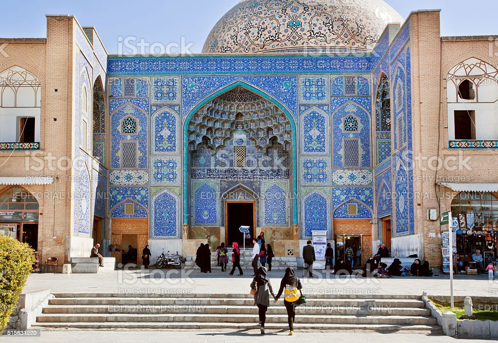 Two girls come to historical mosque of Iran stock photo