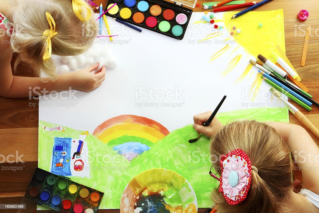Two girls creating art. royalty-free stock photo