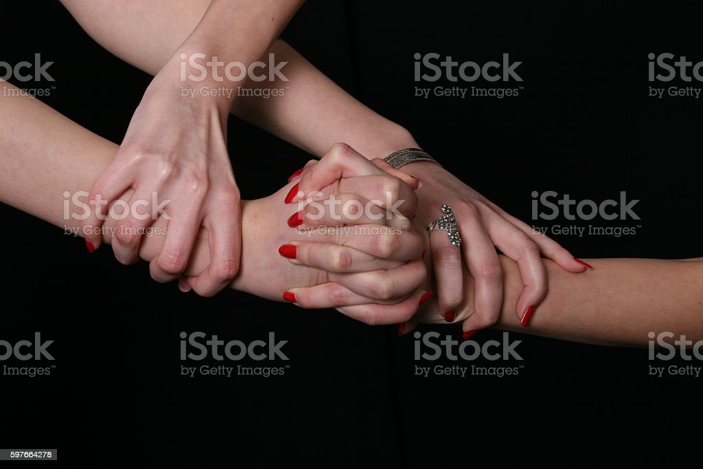 Two girls crossing their hands stock photo