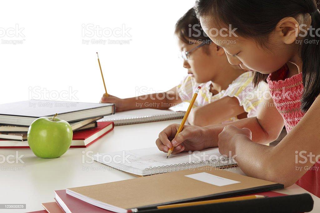 Two Girls Doing Their Homework royalty-free stock photo