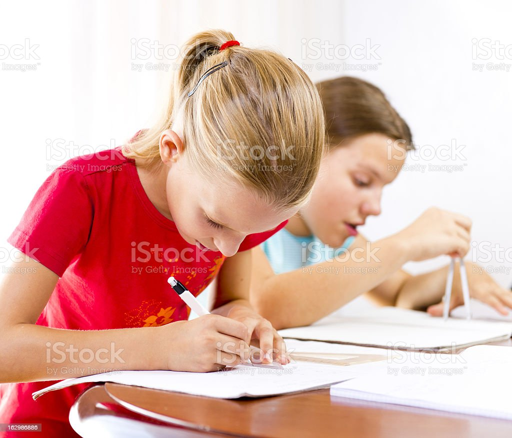 Two girls doing their homework royalty-free stock photo