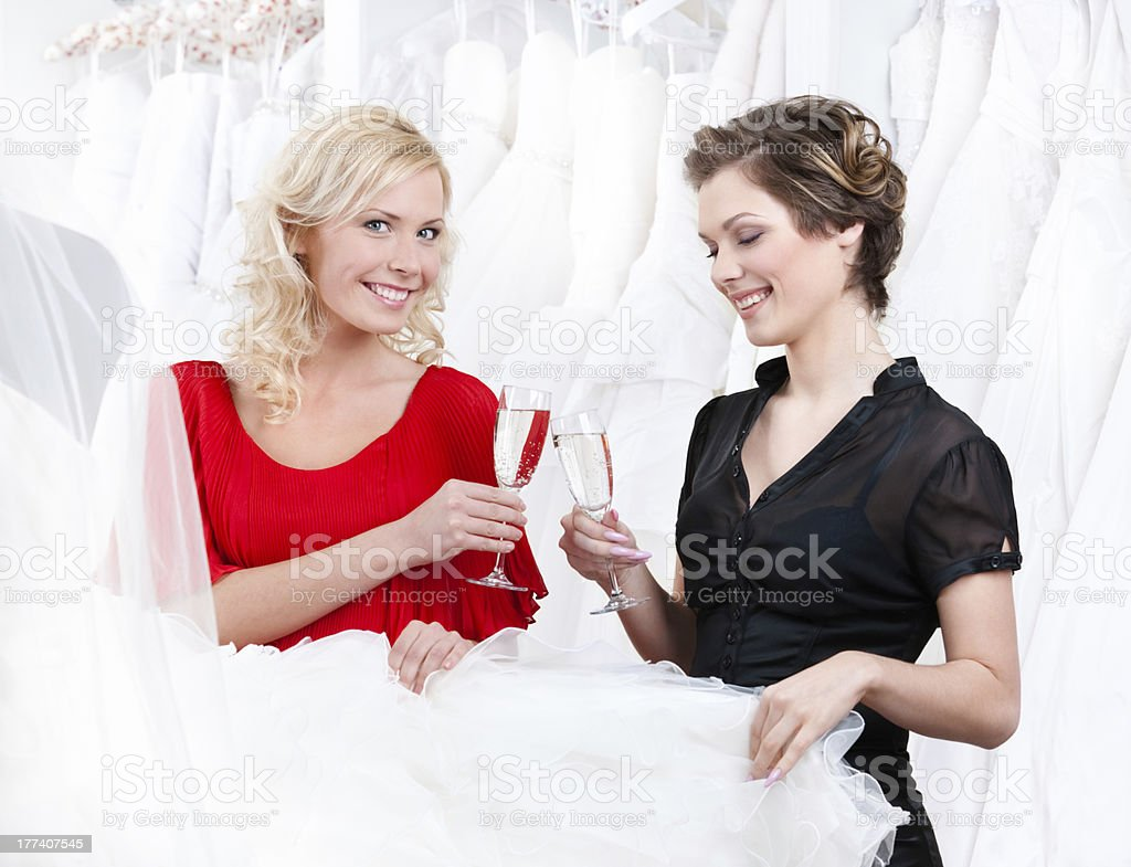 Two girls drink champagne or wine royalty-free stock photo