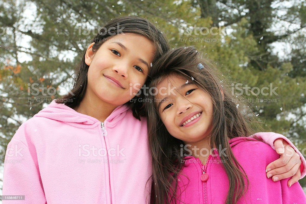 Two girls enjoying the winter royalty-free stock photo
