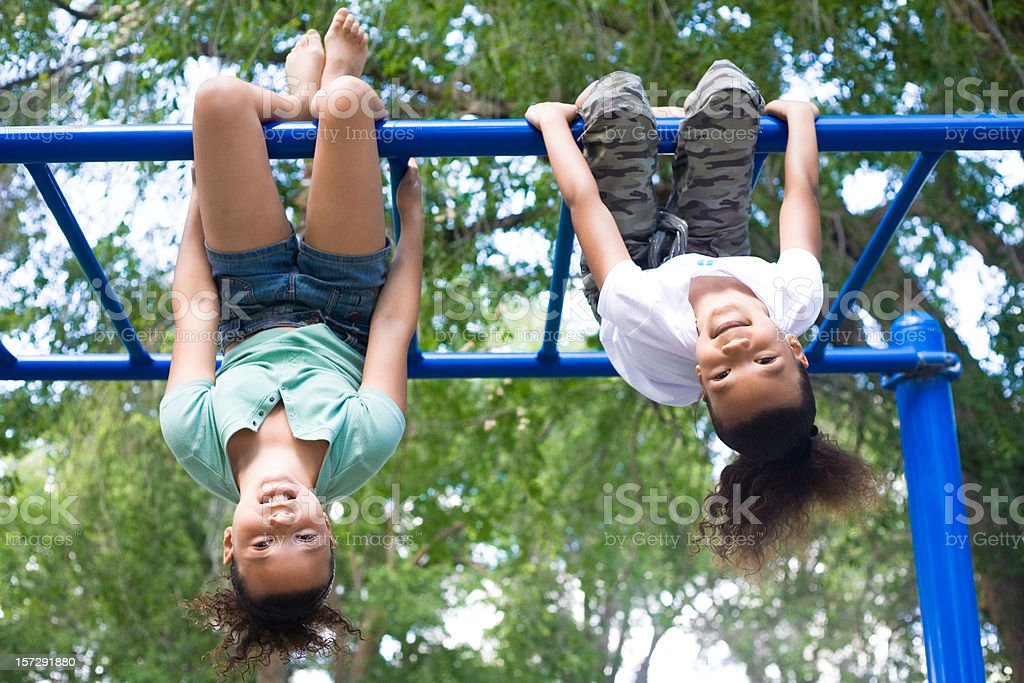 Two Girls Hanging Upside Down stock photo
