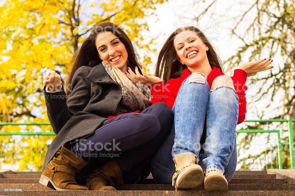 Two girls having fun stock photo