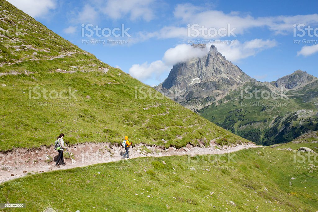 Two girls hiking in the Ayous Lakes Pyrenees stock photo
