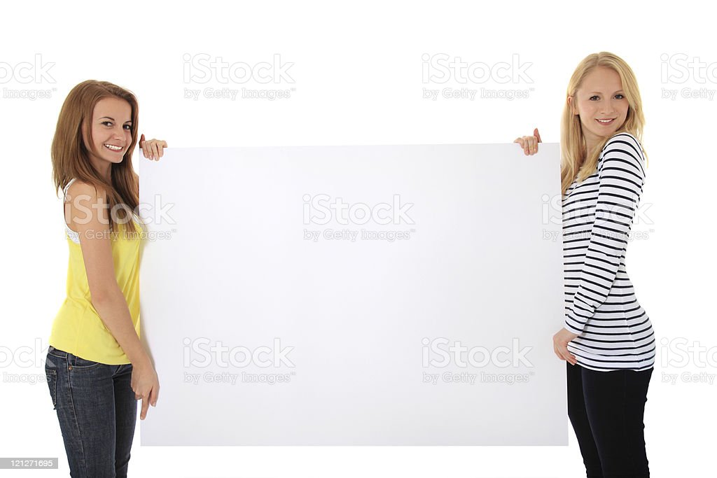 Two girls holding blank white sign stock photo