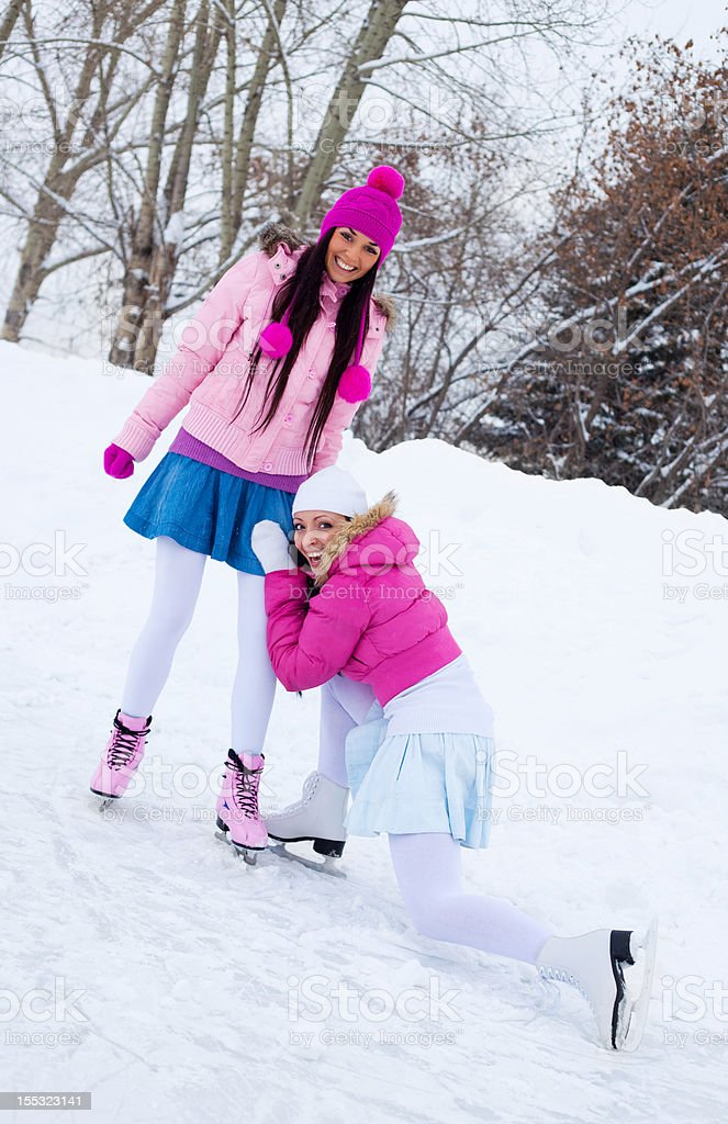 two girls ice skating royalty-free stock photo