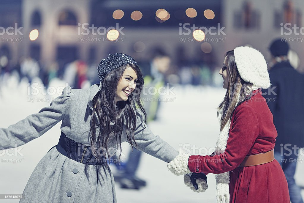 two girls ice skating royalty-free stock photo