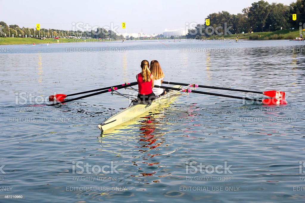 Two girls in a boat stock photo
