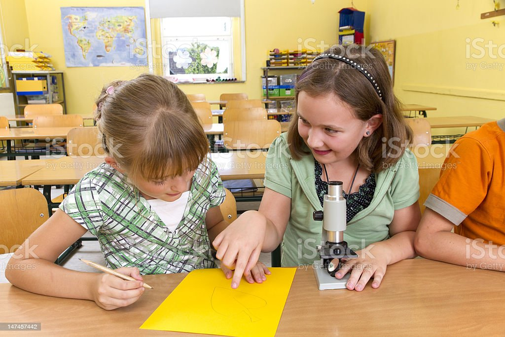 Two Girls in a classroom royalty-free stock photo