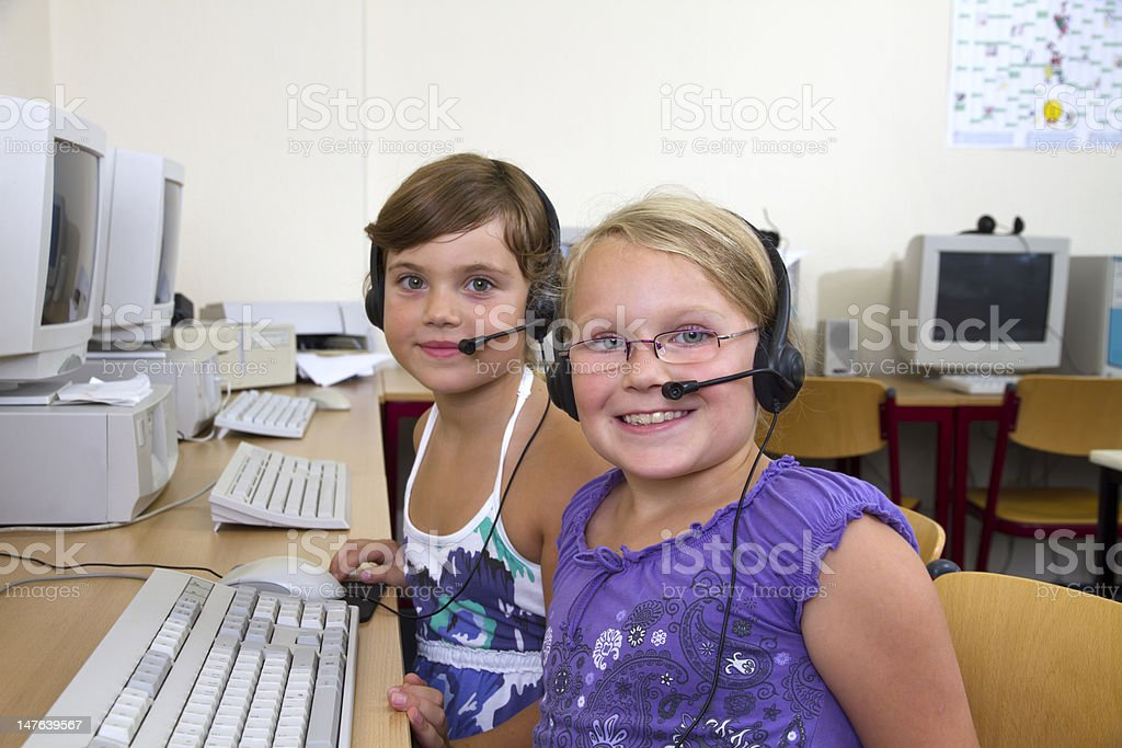 Two Girls in a classroom stock photo