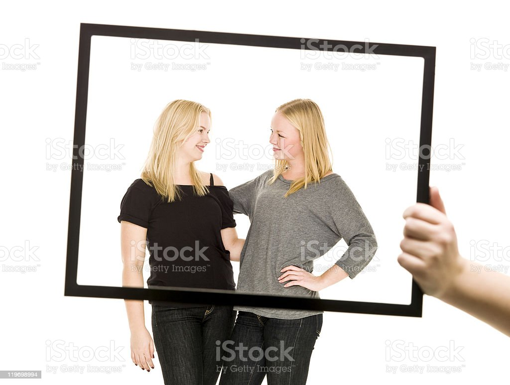 Two Girls in a frame stock photo