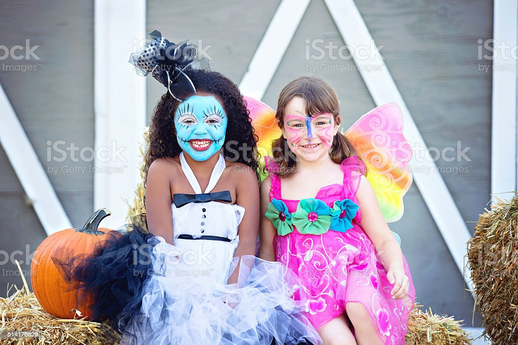 Two Girls In Costume at A Halloween Party stock photo