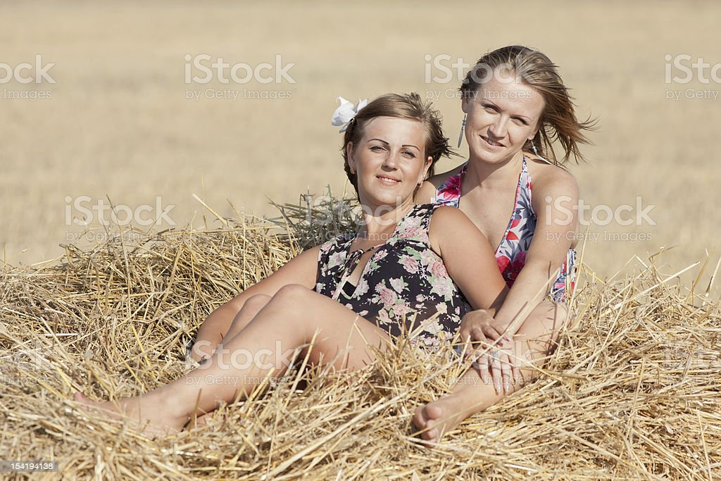 Two girls in field royalty-free stock photo