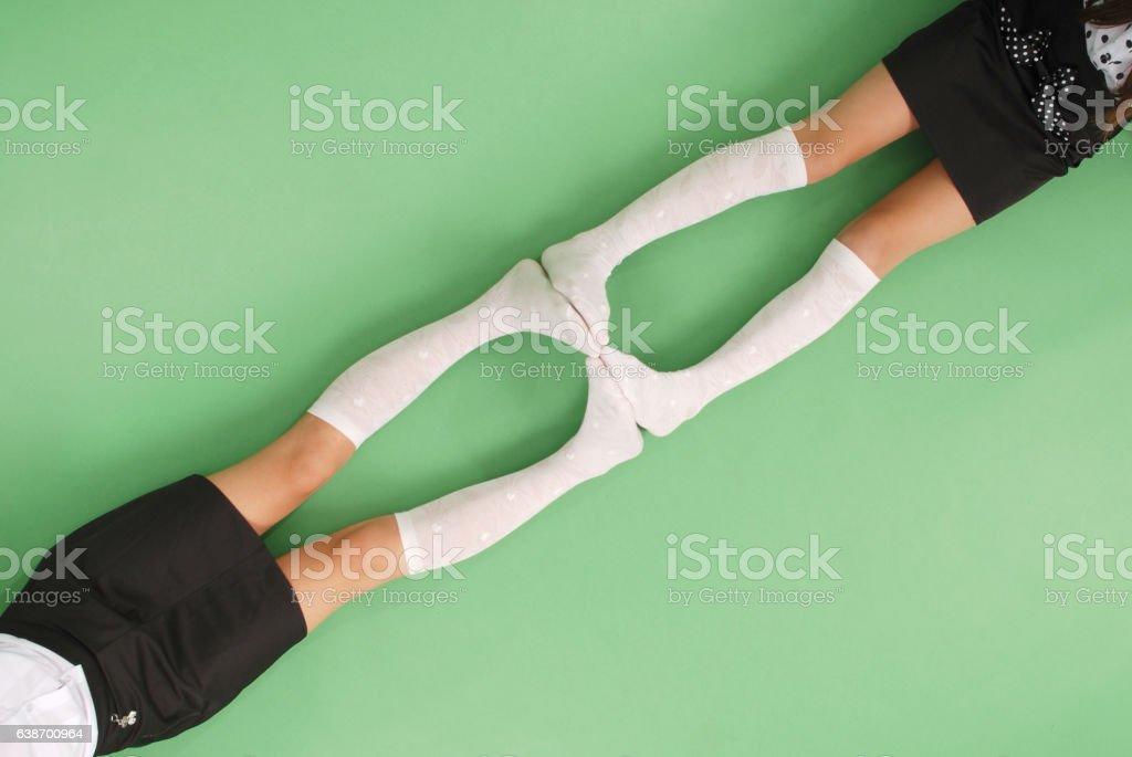 Two girls in knee-length socks stock photo