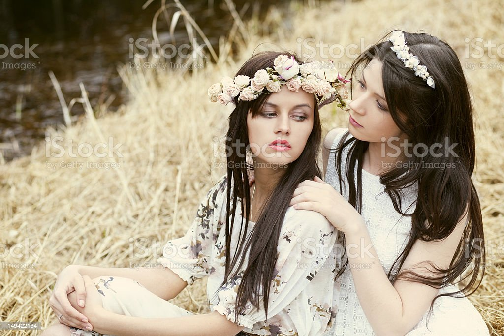 Two girls in the hay royalty-free stock photo
