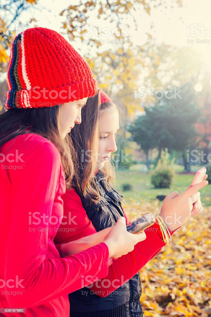 Two girls looking at mobile phone royalty-free stock photo