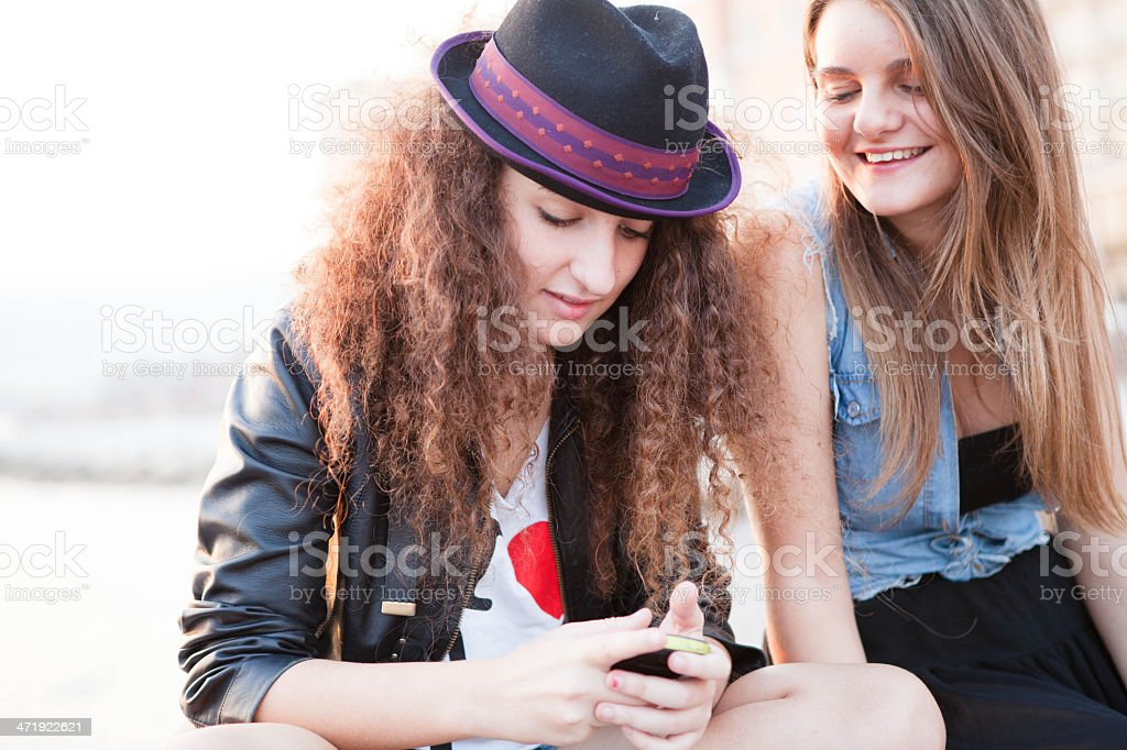Two Girls Looking at Smartphone royalty-free stock photo