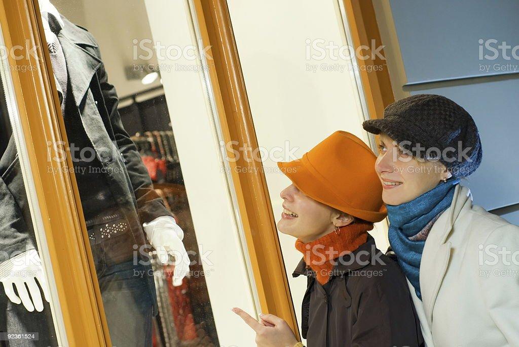 Two girls near the shop window royalty-free stock photo