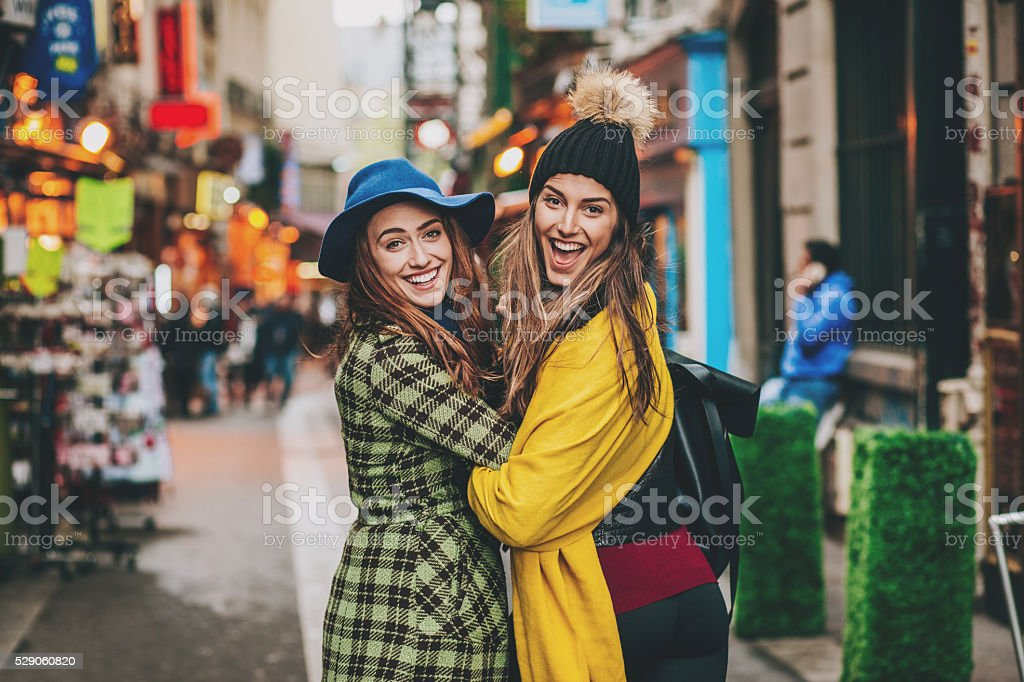 Two girls on a shopping street in Paris city stock photo