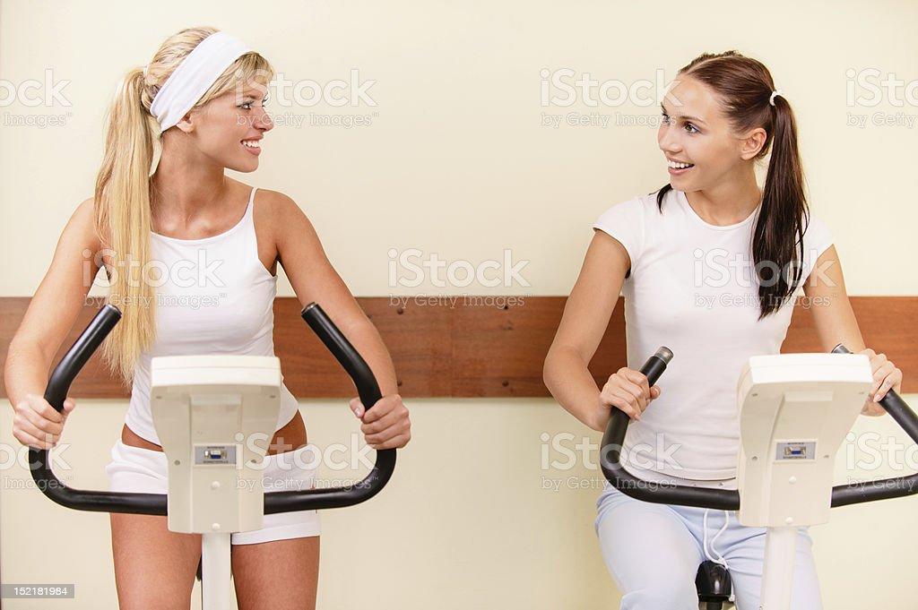 Two girls on velosimulators royalty-free stock photo