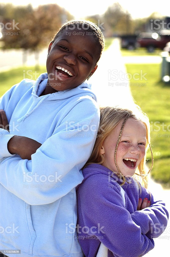 Two Girls Outside Having a Moment of Laughter royalty-free stock photo
