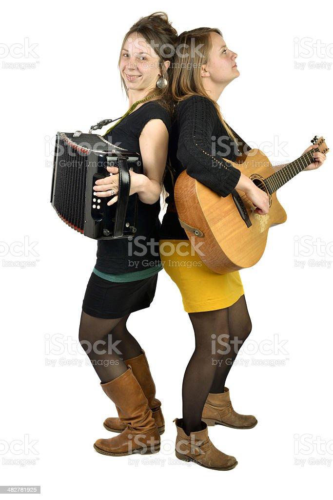 Two girls playing music royalty-free stock photo