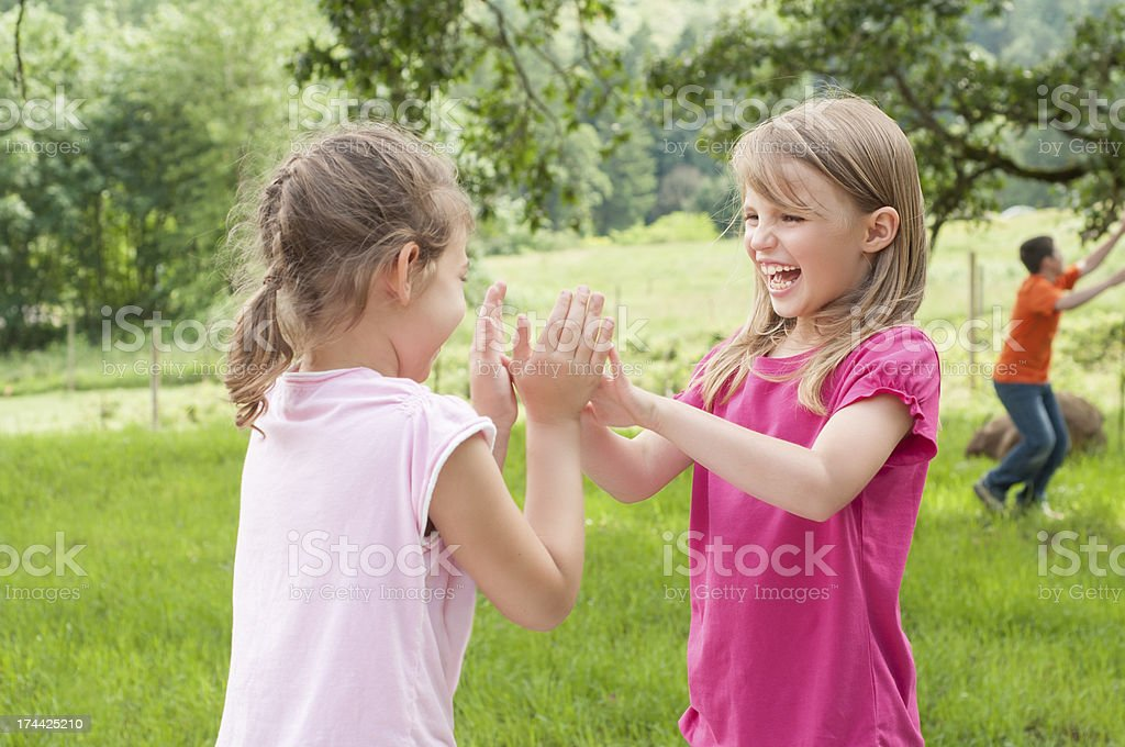 Two Girls Playing Patt-a-cake stock photo