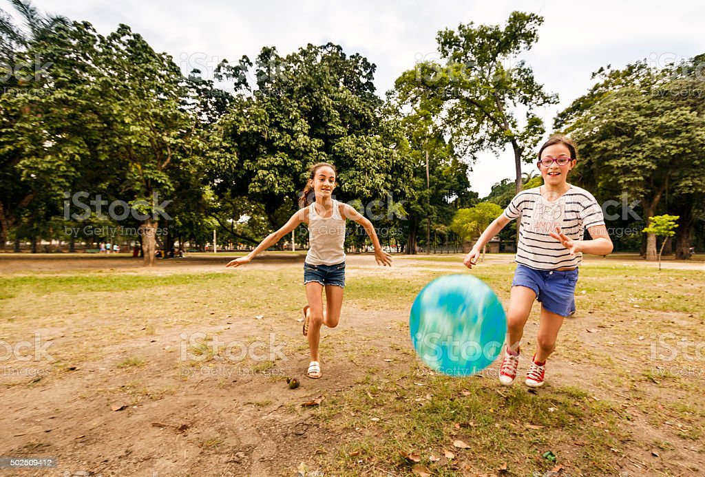 Two Girls Playing With Ball in a Park stock photo