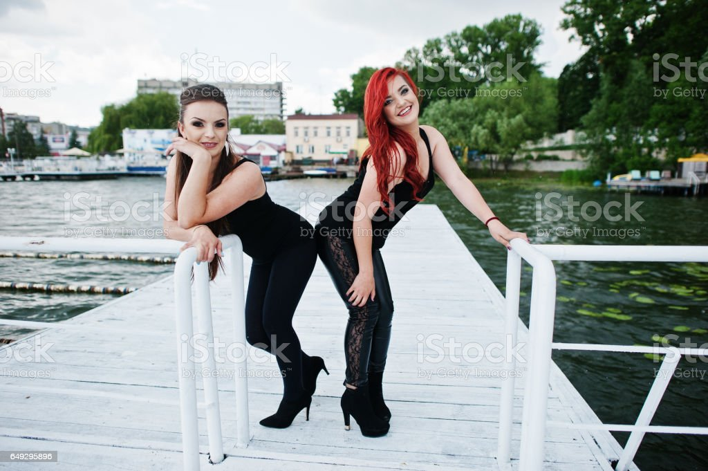 Two girls posed at the pier stock photo