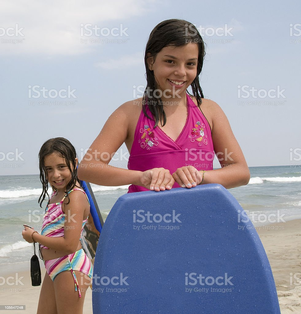 Two Girls Prepare to Boogie Board stock photo