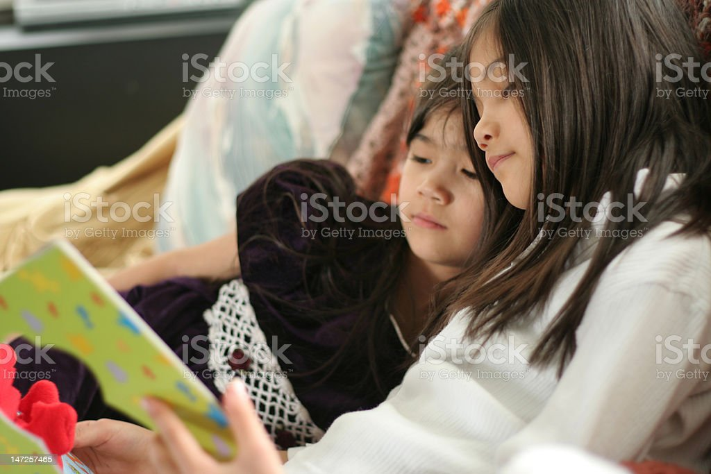 Two girls reading a book royalty-free stock photo