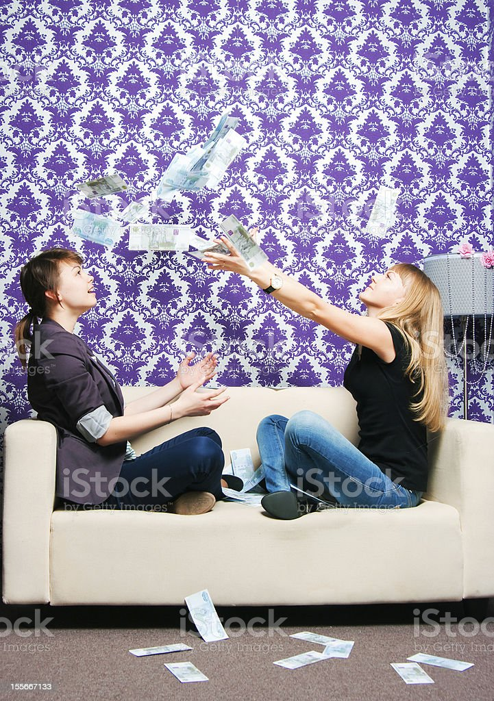 two girls scatter Russian rubles stock photo