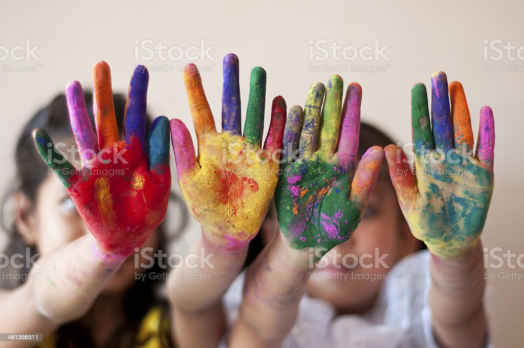 Two girls showing colorful painted hands stock photo