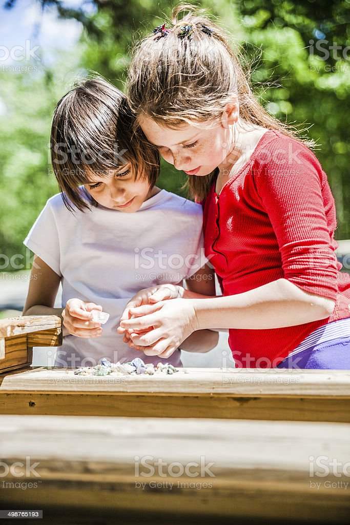 Two girls, sisters, mining minerals stock photo