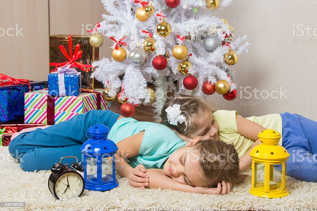 Two girls slept through the whole New Years Eve at stock photo