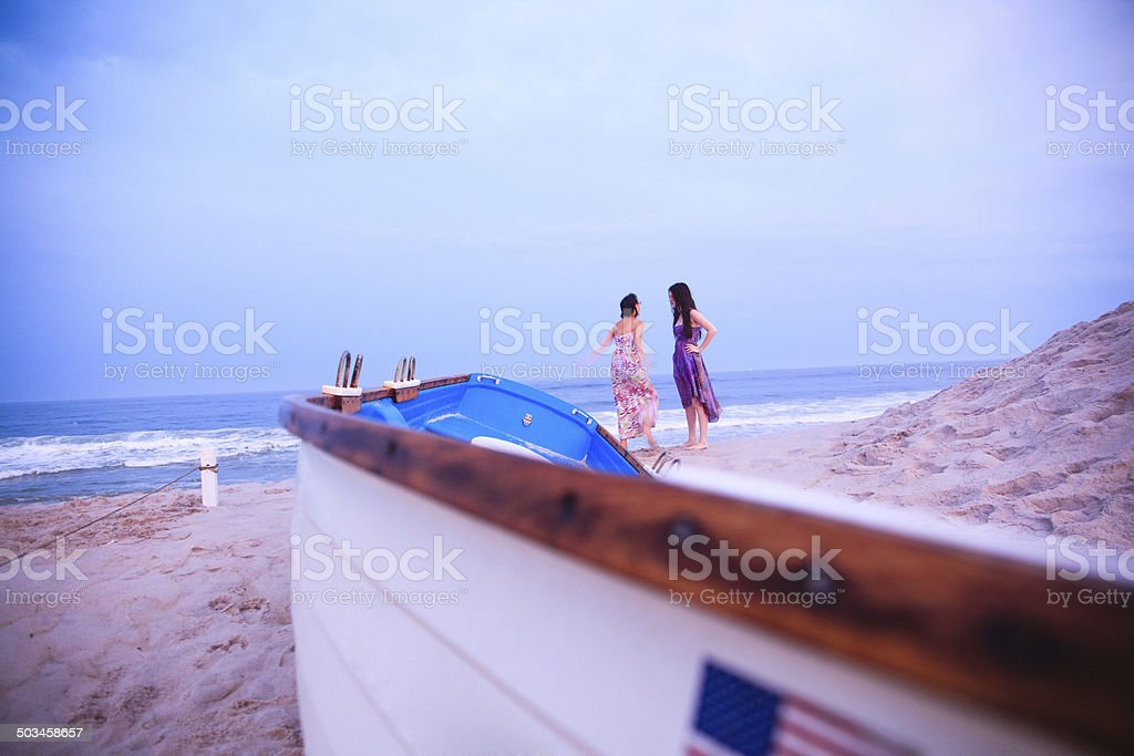 Two girls stay at the Jones Beach at the sunset stock photo