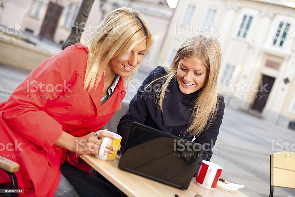 Two girls surfing on web in a caffee royalty-free stock photo