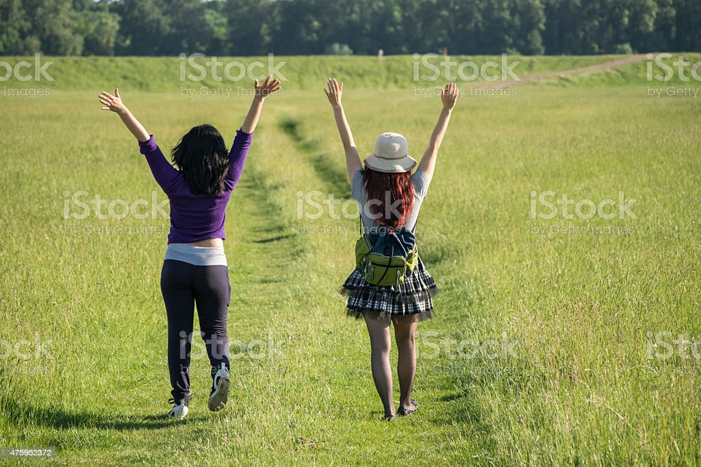 Two girls traveling and cheering stock photo