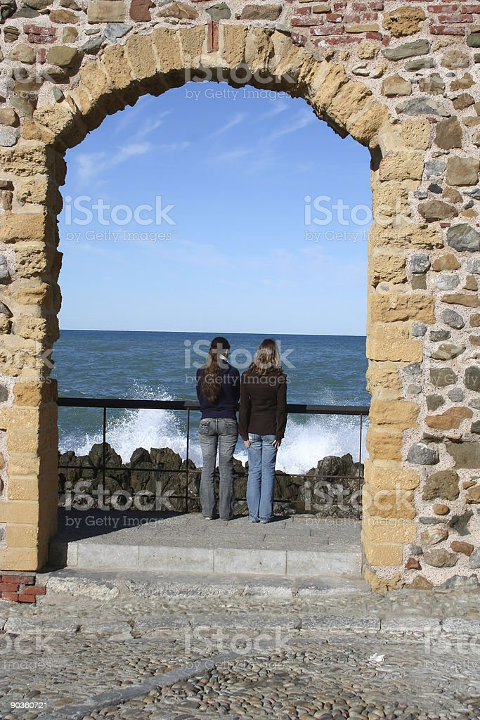 two girls watching the surf royalty-free stock photo