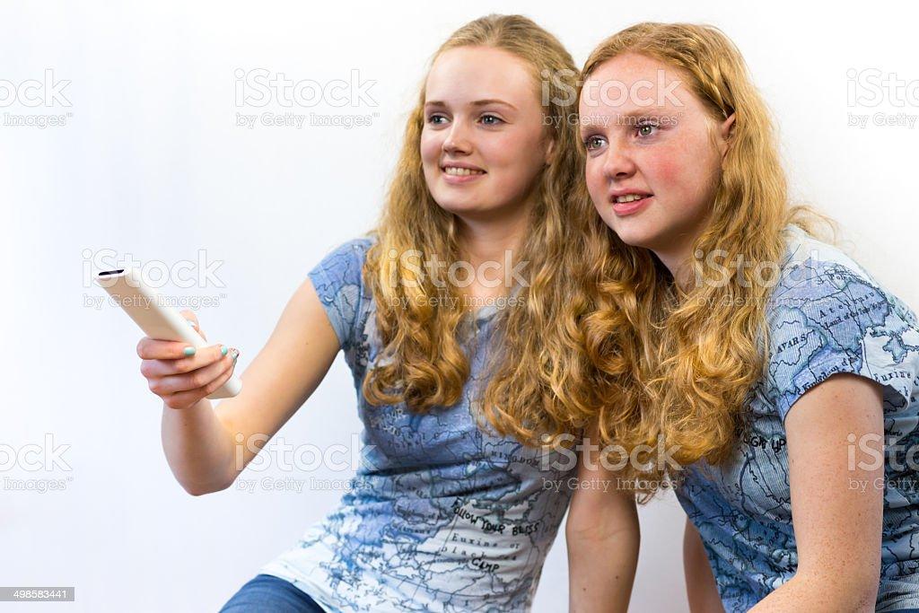 Two girls watching TV stock photo