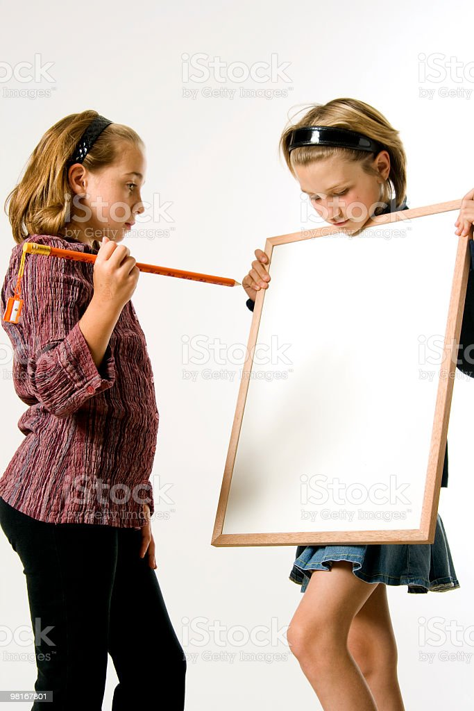 Two girls with a blank white sign royalty-free stock photo