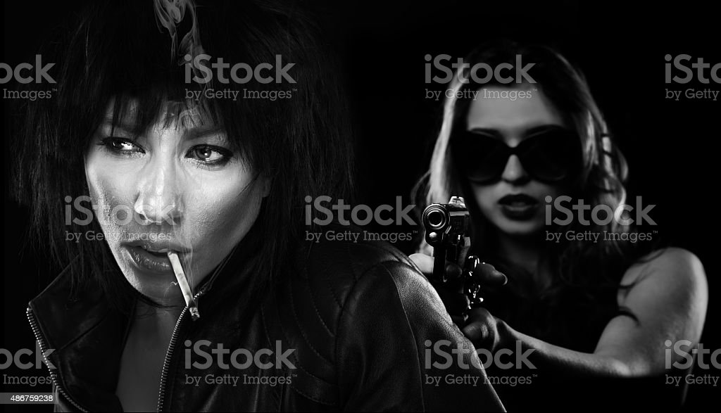 Two girls with a gun stock photo