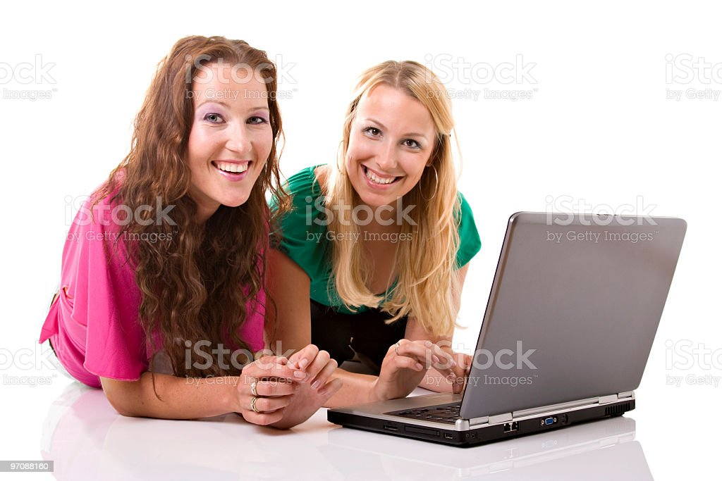 Two girls with a laptop royalty-free stock photo