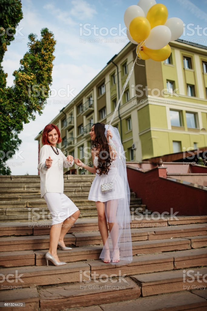 Two girls with balloons at hand on hen party. stock photo