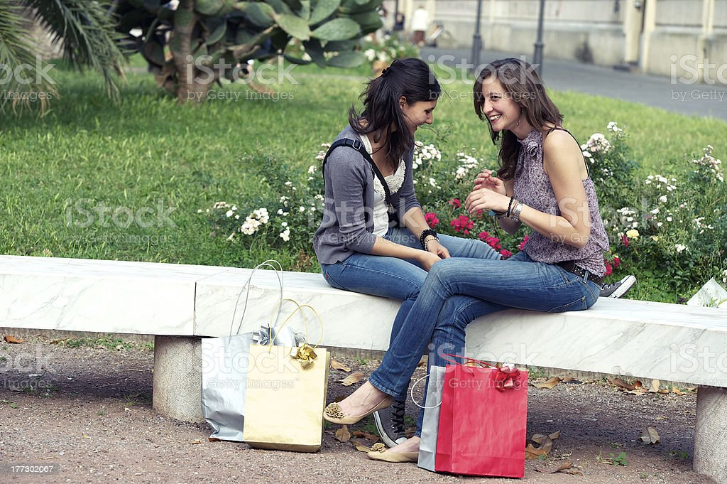two girls with colored bags outdoor royalty-free stock photo