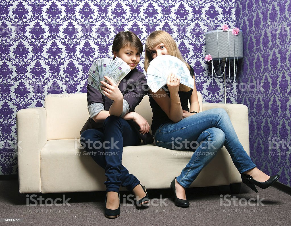Two girls with fans from the Russian bank notes stock photo