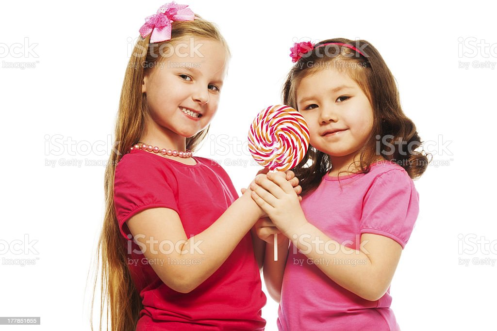 Two girls with lollipop royalty-free stock photo